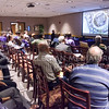 A number of K-State students, faculty and staff listen to Andrew Peters of Workshop Architects, Inc., explain details of the firm's designs for renovation of the K-State Student Union Thursday afternoon in the Union. (Parker Robb | The Collegian)