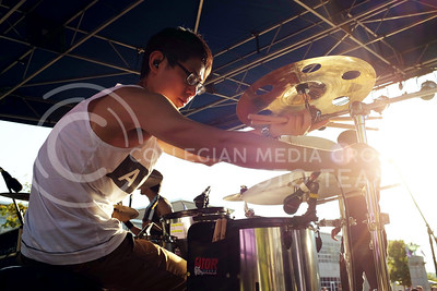Wu Yi, drummer for post-hardcore band Waxeye, adjusts his kit before performing at the OPUS band competition Friday evening, Sept. 26, 2014. (Vail Moshiri | The Collegian)
