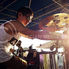 Wu Yi, drummer for post-hardcore band Waxeye, adjusts his kit before performing at the OPUS band competition Friday evening, Sept. 26, 2014. (Vail Moshiri   The Collegian)
