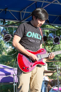 Alex Shaw   Collegian Media Group  Perian Wang backs up Lei Tang playing Guitar in Waxeye at the Opus Band Showcase Sept, 26, 2014