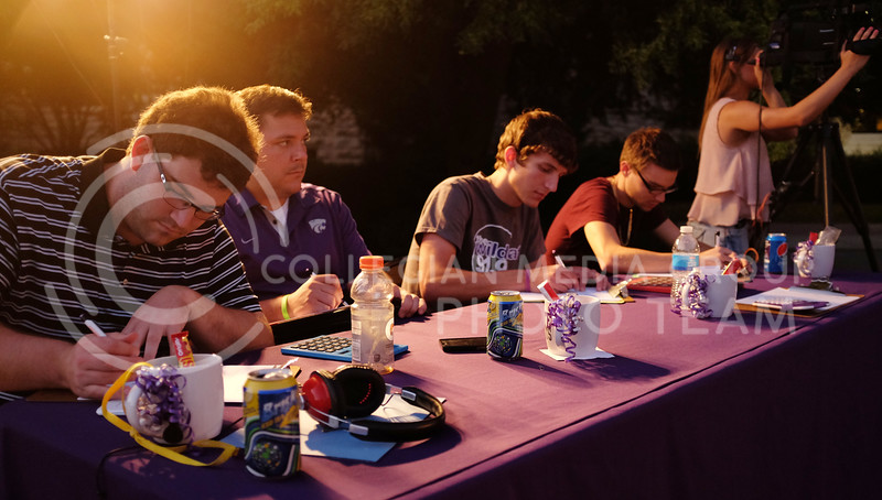 A panel of judges evaluate the performances the evening of the OPUS band competition, Friday, Sept. 26, 2014. (Vail Moshiri   The Collegian)