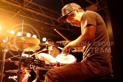 Brad Hodge, drummer of Jade Archetype, performs during the OPUS band competition in Bosco Plaza on Friday evening, Sept. 26, 2014. (Vail Moshiri | The Collegian)