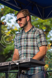 Alex Shaw   Collegian Media Group  Marcus Grimes plays Keyboard and Sings vocals Durring the Whooligans Profoemance at the OPUS Band Competition