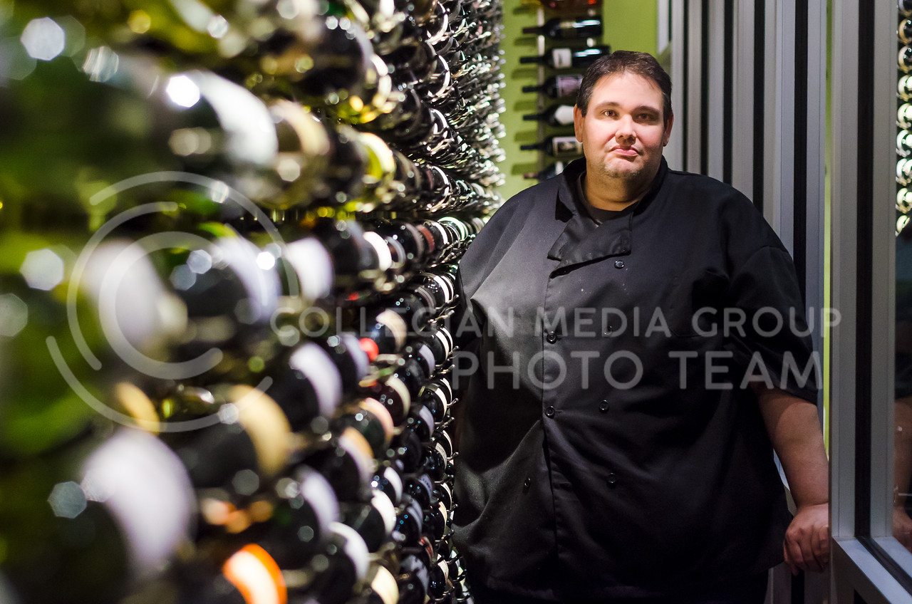 Scott Benjamin, owner and chef at 4 Olives in downtown Manhattan, discovered his passion for wine while working at a winery as a teenager, which eventually led him to open 4 Olives, the only restaurant in Kansas to achieve the Wine Spectator Best of Award of Excellence. His wife, Rachel, operates the 4 Cakes bakery next door. (Parker Robb | The Collegian)