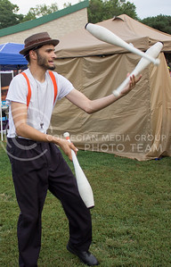 (Photo by Alexander Shaw | The Collegian)   Professional entertainer, Tim Dingus, entertains a crowd with his juggling routine at Purple Power Play in the Park on Aug. 28, 2014.
