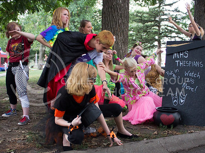 (Photo by Alexander Shaw | The Collegian)   Hichschool Thespains Mime along for donations at the Purple Power Play