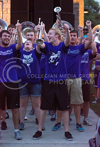 Photo by George Walker | The Collegian  Part of the trumpet section jams out during a song at Purple Power Play in Manhattan City Park on Aug. 28, 2014.