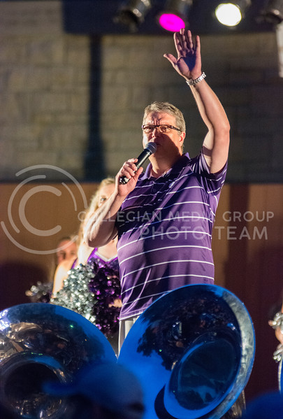 Photo by George Walker   The Collegian<br /> <br /> Dr. Frank Tracz, KSU Band Director, pumps up the crowd at Purple Power Play in Manhattan City Park on Aug. 28, 2014.