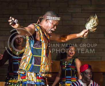 Dancing the Bewaa, a traditional dance by the  Dagara People of Ghana, the dancers formed a circle around the drummers in the center of the stage. The Saakumu Dance Troupe offered a free concert in All Faiths Chapel on Feb. 3. (Mason Swenson | The Collegian)
