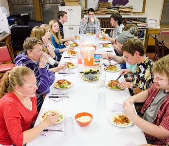 Smith men and Smurthwaite ladies enjoy a meal together at Smith during an exchange dinner between the two scholarship houses November 13, 2014. Smith and Smurthwaite also hold many other social events together throughout the school year. (Parker Robb | The Collegian)
