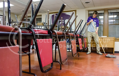 Joel Rice, freshman in chemical engineering, mops the dining room of Smith Scholarship House November 12, 2014. Men of Smith maintain their house and their community, also procuring lower rent, by taking turns doing all the chores. (Parker Robb | The Collegian)