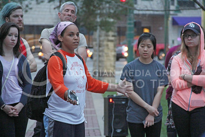 Jasmine Davis, senior in sociology, speaks with the crowd before the Take Back the Night March in Triangle Park on April 16, 2015. (Vail Moshiri | The Collegian)