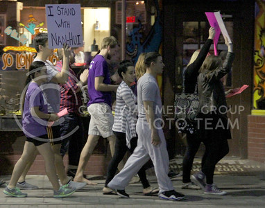 Students march through Aggieville for Take Back the Night on Thursday. (Vail Moshiri | The Collegian)