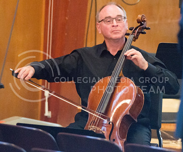 """Dr. David Littrell, guest cello soloist, performs """"Remember Me"""" during the Kansas State University Wind Ensemble's Carnegie Hall Send-Off Concert in All Faiths Chapel on March 30, 2015. (George Walker 