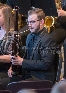"""Marcus Grimes, senior in social sciences, plays the basoon during the  Kansas State University Wind Ensemble's performance of """"First Suite in E-flat for Military Band"""" during the Carnegie Hall Send-Off Concert in All Faiths Chapel on March 30, 2015. (George Walker 