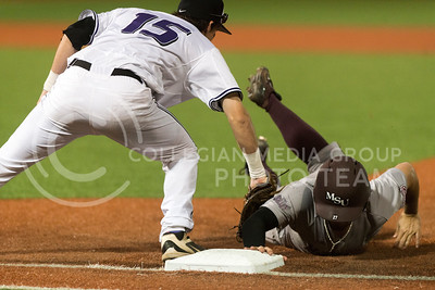 Senior first base Shane Conlon tags out a Missouri State player during the Wildcats March 13 game at Tointon Family Stadium. The Cats won the first of three games played over the series. (Evert Nelson | The Collegian)
