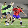 Jacquelyn Ewald, senior in civil engineering, right, tries to gain possession from Erin Ridder, freshman in life sciences, during the Women's Club Soccer team's practice Wednesday evening at Old Stadium. (Parker Robb | The Collegian)