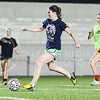 Bailey Snyder, sophomore in nutrition and kinesiology, dribbles into her attacking third past Cipriana Sapien, sophomore in business administration, right, and Anna McVicker, freshman in animal sciences and industry, left, during the Women's Club Soccer team's practice Wednesday evening at Old Stadium. (Parker Robb | The Collegian)