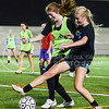 Anna McVicker, freshman in animal sciences and industry, right, and Lindsay Rucker, freshman in life sciences, challenge eachother for the ball during the Women's Club Soccer team's practice Wednesday evening at Old Stadium. (Parker Robb | The Collegian)