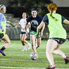 Bailey Snyder, sophomore in nutrition and kinesiology, weaves the ball around teammates Stephanie Rucker, senior in management, front, Amelia Jerome, sophomore in animal sciences and industry left, and Michelle Bowman, sophomore in athletic training, back, during the Women's Club Soccer team's practice Wednesday evening at Old Stadium. (Parker Robb | The Collegian)