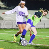 Caroline Peters, freshman in chemical engineering, left, attempts to steal the ball away from Morgan Whitham, senior in accounting, during the Women's Club Soccer team's practice Wednesday evening at Old Stadium. (Parker Robb | The Collegian)