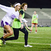 Caroline Peters, freshman in chemical engineering, left, and Lindsay Rucker, freshman in business administration, race toward a loose ball during the Women's Club Soccer team's practice Wednesday evening at Old Stadium. (Parker Robb | The Collegian)