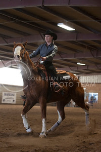 Brynn Critcher, freshaman, rides Dallas during the reining competition at Saturdays meet against Baylor University at Timbercreek Stables. (Evert Nelson | The Collegian)
