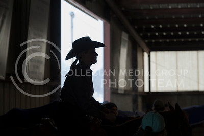 Savannah Smith, senior, waits on Penny right before her ride during the reining competition at Saturdays meet against Baylor University. (Evert Nelson | The Collegian)