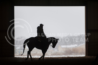 Brynn Critcher, K-State Equestrian freshman, rides Dallas during warmups of the reining competition Saturday at Timbercreek Stables. The Wildcats took on Baylor University during the meet and won, extending their home wins to 18 for the season. (Evert Nelson | The Collegian)