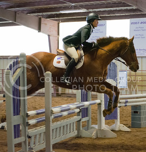 Taylor Schimidt, sophomore hunter seat, rides Flynn during the over fences part of the competition at the K-State vs. Baylor Equestrian meet on Fe. 28, 2015 at Timbercreek Stables. The Wildcats had a victory against #1 bears 10-8. (Cassandra Nguyen | The Collegian)