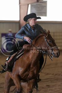 Savannah Smith, senior, rides Penny during the reining competition against Baylor University at Timbercreek Stables Saturday. (Evert Nelson | The Collegian)
