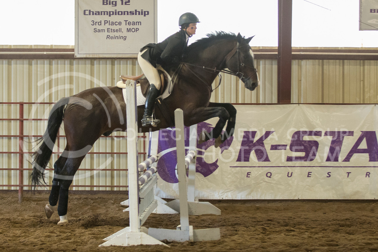 Henley Adkins, sophomore hunter seat, takes a jump on Spot at the Sept. 25, 2014 meet against New Mexico at Timbercreek Stables. (Hannah Hunsinger | The Collegian)