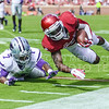Junior centerback Danzel McDaniel (7) tackles Oklahoma wide receiver Durron Neal (5) by shoving him out of bounds during the third quarter of the Wildcats' 31-30 defeat of the Sooners Saturday in Norman, Oklahoma. (Parker Robb   The Collegian)
