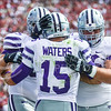Senior quarterback Jake Waters celebrates with junior left tackle Cody Whitehair (right) and junior right guard Luke Hayes (left) after scoring K-State's game-winning touchdown in the third quarter of the No. 14-ranked Wildcats' 31-30 upset of the No. 11-ranked Sooners October 18, 2014, at Gaylord Family Memorial Stadium in Norman, Oklahoma. (Parker Robb   The Collegian)