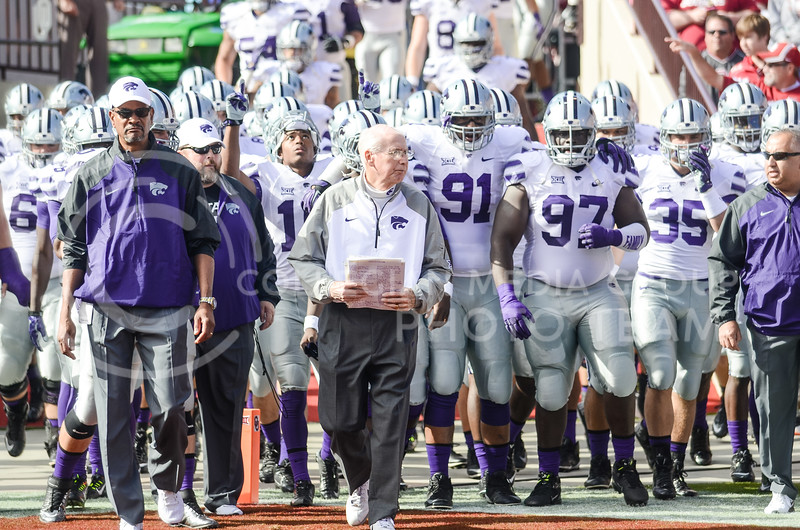 Head coach Bill Snyder leads the #14-ranked Wildcats from the locker room onto the field ready to take on the #11-ranked Oklahoma Sooners Saturday morning at Gaylord Family Memorial Stadium in Norman, Oklahoma.  (Parker Robb   The Collegian)