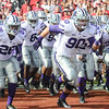 Senior defensive end Laton Dowling leads his fellow Wildcats onto the field prior to their game against the Oklahoma Sooners October 18, 2014, at Gaylord Family Memorial Stadium in Norman, Oklahoma. (Parker Robb   The Collegian)