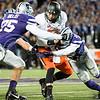 K-State defensive end Jordan Willis and defensive back Randall Evans sack Oklahoma State quarterback Daxx Garman on Saturday, November 1, 2014 at Bill Snyder Family Stadium. (Emily DeShazer | The Collegian)