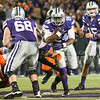 K-State running back Charles Jones breaks through the line on Saturday, November 1, 2014 at Bill Snyder Family Stadium. (Emily DeShazer | The Collegian)