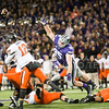 K-State defensive lineman Travis Britz leaps to try and block a pass by Oklahoma State quarterback Daxx Garman on Saturday, November 1, 2014 at Bill Snyder Family Stadium. (Emily DeShazer | The Collegian)
