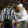 K-State head coach Bill Snyder talks with a referee about a pass interference call on Tyler Lockett's defender Kevin Peterson on Saturday, November 1, 2014 at Bill Snyder Family Stadium. (Emily DeShazer | The Collegian)