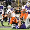 Oklahoma State running back Tyreek Hill is tackeled by K-State defensive end Ryan Mueller on Saturday, November 1, 2014 at Bill Snyder Family Stadium. (Emily DeShazer | The Collegian)