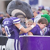 Willie the Wildcat signs a fan during the Sunflower Showdown at Bill Snyder Family Stadium on Nov. 29, 2014. (George Walker   The Collegian)