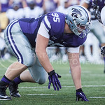 (Photo by Emily DeShazer | The Collegian)  Junior defensive lineman Travis Britz lines up on the line of scrimmage on August 30, 2014 at Bill Snyder Family Stadium.