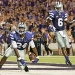 Photo by George Walker | The Collegian  Sophomore running back Charles Jones begins to celebrate after a touchdown on Aug. 30, 2014 at Bill Snyder Family Stadium.