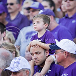 (Photo by Emily DeShazer | The Collegian)  A boy sits on the shoulders of a K-State fan on August 30, 2014 at Bill Snyder Family Stadium.