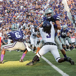Photo by Rodney Dimick | The Collegian Stephen F. Austin defensive back Keavon Madison is holding on while being taken by a K-State player on August 30, 2014 at Bill Snyder Family Stadium.