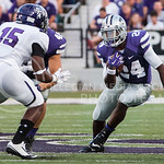 (Photo by Emily DeShazer | The Collegian)  Sophomore running back Charles Jones changes directions as he rushes downfield on August 30, 2014 at Bill Snyder Family Stadium.
