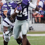 (Photo by Emily DeShazer | The Collegian)  Sophomore running back Charles Jones rushes down field on August 30, 2014 at Bill Snyder Family Stadium.