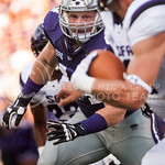 (Photo by Emily DeShazer | The Collegian)  Senior defensive end Ryan Mueller rushes to the quarterback on August 30, 2014 at Bill Snyder Family Stadium.