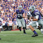 (Photo by Rodney Dimick | Collegian) Senior quarterback Jake Waters charges down the field on August 30, 2014 at Bill Snyder Family Stadium.